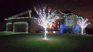 people who hang christmas lights pin by we hang christmas lights on i love christmas lights