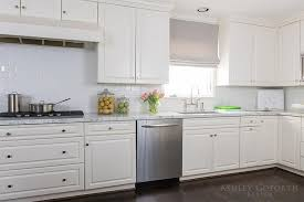 antique white kitchen cabinets with subway tile backsplash white kitchen cabinets with white subway tiles