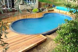 Landscaping Around Pools by Deck Around Pool Skimmer Landscaping Around Pool Deck Ideas Wooden