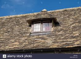 cotswold stone roof tiles dormer window bourton on the water stock