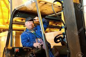 Forklift Mechanic Worker Driver Of A Forklift Loader In Blue Workwear At Warehouse