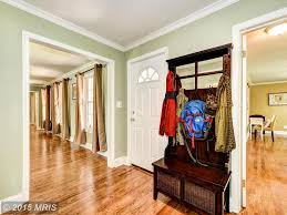 traditional entryway with crown molding u0026 hardwood floors in upper