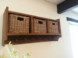 Coat Storage Ideas Breathtaking Wall Coat Storage Baskets Design With Cream Wall