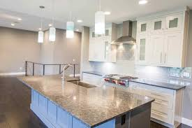 modern homes essick builders this home is a wonderful example of a clean crisp open floor plan home with white custom cabinets large painted island and dark hardwood floors