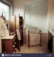 real homesbathroom with tiled floor shower over bath wooden