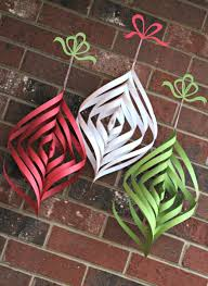 nice diy christmas decorations with colorful spirals paper on red