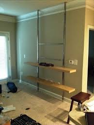 Wall Mounted Entertainment Shelves How To Create A Floor To Ceiling Tv Entertainment Center
