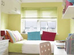 organize small bedroom ideas light yellow wall paint color glossy