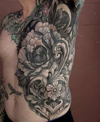 peony and filigree torso tattoo by laura jade tattoonow