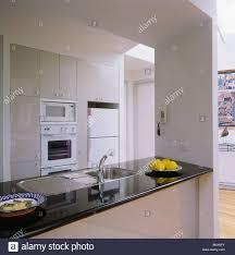 What Is Corian Worktop Stainless Steel Sink In Black Corian Worktop In Modern White