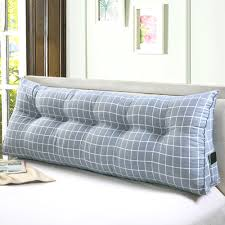 large bed pillows a large wooden bed with luxury pillows wooden