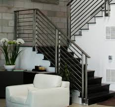 futuristic modern stairs ideas with black glass banister and stair