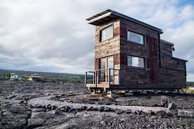 off grid tiny house is located in the middle of a lava flow curbed