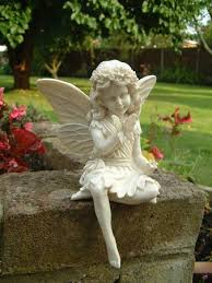 small sitting with a flower and butterfly garden ornament