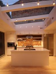 kitchen skylight kitchenisland exposedbrick photo credit dennis
