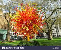 dale chihuly multicolored murano glass tree in a park
