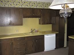 classy brown color formica kitchen cabinets with cream color