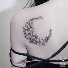 crescent moon shaped white floral by zihwa tattooer