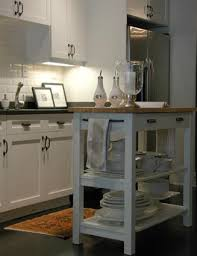 small white kitchen island white island with butcher block top transitional kitchen