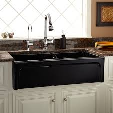 white farmhouse sink apron sink white cabinets dark counter tops
