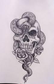 skull and snake designs 35 amazing skull and snake tattoos