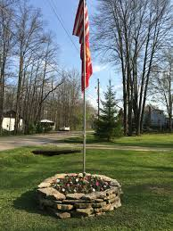 rock ring flower bed around flag pole backyard diy pinterest
