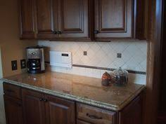 Kitchen Granite And Backsplash Ideas by Dark Cabinets With New Venetian Gold Granite And Tumbled Marble