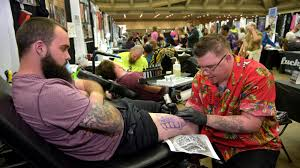 stories on skin scenes from the baltimore tattoo arts convention