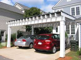 nice simple design of the homes with carports that has white wall
