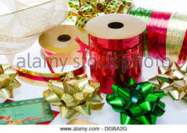 christmas ribbon bows rolls of festive christmas present gift wrap wrapping paper