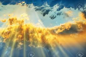 sunset beautiful blue sky with sun shining through clouds stock
