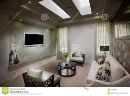 a beautiful decent moody living room with a tv stock photo image