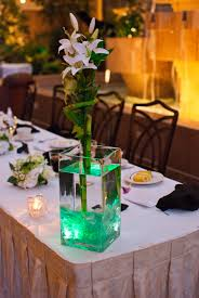 diy bamboo and lily centerpieces with cut sea glass and