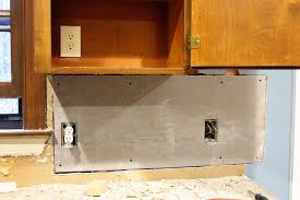 under cabinet light with outlet the handcrafted life short term kitchen update goodbye pelmet