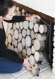 fake a stack of wood logs in your fireplace fireplace facade
