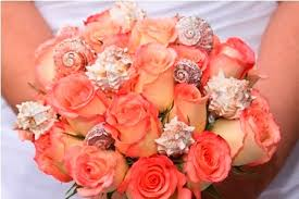 wedding bouquets with seashells orange roses and seashells wedding bouquet wedding