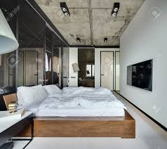 hall in a loft style with white walls and concrete ceiling there