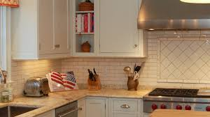 backsplash designs for kitchen black range hood wooden exposed
