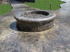 Concrete Fire Pit by Stamped Concrete With Fire Pit In Middle Is A Flush Style Fire