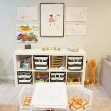 playroom table with storage love the simplicity of this playroom especially the striped basket