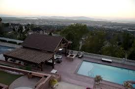 showy steep sloped backyard pool house pavilion u0026 pergolas