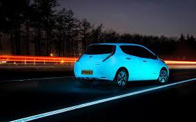 nissan leaf next generation phosphorescent nissan leaf on glowing highway looks like a scene
