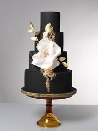 wedding cake makers fantasia black and gold with flower cake the sweet