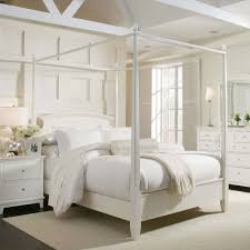 assembling a queen canopy bed frame modern wall sconces and bed