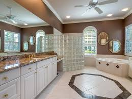 7314 westminster ct university park fl 34201 mls a4193397 master bath with two separate vanities walk in shower and jacuzzi tub crown