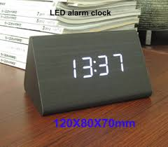 digital alarm clock on nightstand