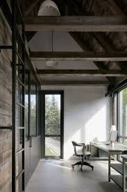 432 best modern rustic images on pinterest modern rustic homes alain carle architecte has completed a home in rural quebec made up of a cluster of blackened wood volumes that step down the sloping site