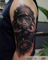 left half sleeve crying eye and gas mask tattoo