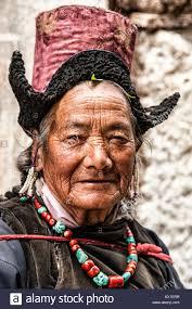 clothing for elderly elderly woman on pilgrimage at gompa ladakh dressing traditional