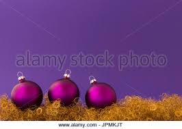 beautiful purple christmas balls with satin effect and metallic